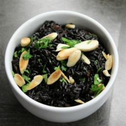 Black Rice Recipe - This black rice pilaf with onion and almonds is a unique, flavorful side dish that is quick and easy to make and pairs well with many mains.