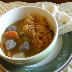 Homemade Albondigas Soup Recipe - Meatballs flavored with cilantro simmer in a gently-seasoned broth with potatoes and carrots. This soup is soothing on a cold, rainy day.