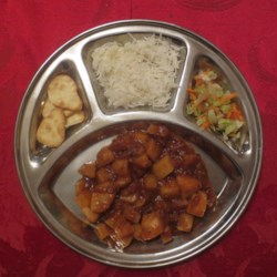 Geeta Auntie's Potato (and Vegetable) Bhaji Recipe - Potato and vegetable bahji, a nicely spiced Indian vegetable dish, is a perfect dinner for two. Serve with basmati rice and naan.