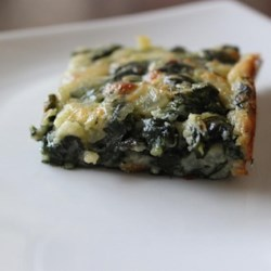 Spinach Brownies Recipe - Spinach and mozzarella cheese are baked together to make irresistible savory appetizer treats.