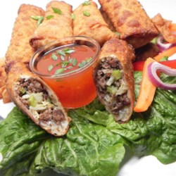 Korean Mandu (Egg Roll) Recipe - Wonton wrappers are stuffed with ground beef and pork in these Korean mandu, also known as fried egg rolls.