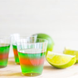 Layered Margarita Jell-O(R) Shots Recipe - Alternating layers of Jell-O(R) spiked with triple sec and tequila make these colorful Margarita shots perfect for Game Day celebrations.