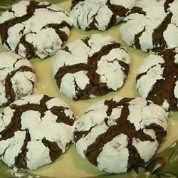 "Chocolate Crinkles I Recipe - These chocolate cookies are rolled in powdered sugar and  ""crack"" when you bake them."