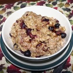 Cranberry-Orange Spiced Oatmeal Recipe - Start your day with a wholesome breakfast of old-fashioned oatmeal seasoned with cinnamon, blueberries, and dried cranberries, sweetened with orange juice, and cooked in minutes in the microwave. Add optional ginger and turmeric for a flavorful twist.