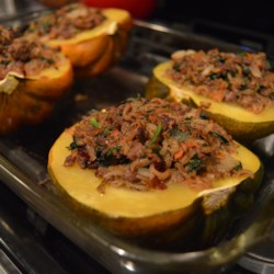 Venison and Wild Rice Stuffed Acorn Squash Recipe - Spiced venison and wild rice make up the stuffing for these baked acorn squash.  This makes an unusually good one-dish main course.