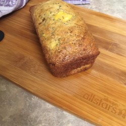 Peach and Poppy Seed Bread Recipe - Peaches, honey, and turbinado sugar sweeten this quick bread accented with poppy seeds.