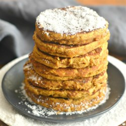 Pumpkin Coconut Pancakes Recipe - Pumpkin, almond butter, and banana make these flourless pancakes full of sweet flavors, with a light and fluffy texture from coconut flour.