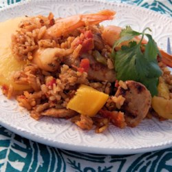 Jambalaya with Fresh Fruit Recipe - Inspired by the classic Cajun dish, this version of jambalaya adds pineapple, mango, and apple to give a sweet accent to a spicy combination of rice, tomatoes, bell peppers, garlic, chicken apple sausages, and shrimp.