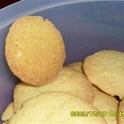 Cornmeal Coconut Cookies Recipe - These tender cornmeal cookies have the tropical taste of lime, coconut, and a hint of rum to take your tastebuds on a sunny trip, even in the wintertime.