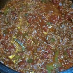 Stuffed Pepper Soup I Recipe - Browned ground beef is combined in this tomato based soup with chopped green peppers, cooked rice, beef bouillon,  brown sugar and soy sauce.