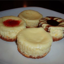 Cheesecake Cupcakes Recipe - When I make these, people just RAVE about them!  Mini cheesecakes with sour cream topping.