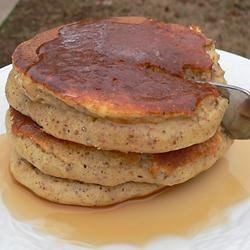 Fluffy Pancakes with Wheat Germ and Applesauce Recipe - Whole wheat flour and wheat germ add depth to the flavor of these pancakes sweetened with applesauce. This is a recipe passed down from my husband's family in Wales. We added some ingredients to make it a little more healthy for our kids. Add fruit if you like and top with real maple syrup... yummy!