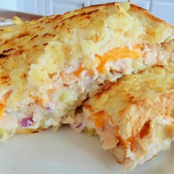 Mary Pat's Tuna Melt Recipe - Crispy potato chips add a crunchy crust to these zesty tuna melts with pickles and red onion, perfect for a creamy, cheesy dinner for 2.
