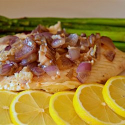 Pan-Grilled Tilapia with Lemon and Red Onion Recipe - Tilapia is seasoned with fresh lemon juice and pan-grilled with red onion for a quick and easy light lunch, great paired with a Greek salad.