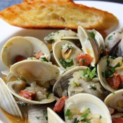 Chorizo Steamed Clams Recipe - These flavorful steamed clams are not only easy and delicious they're also fast to make. Plus there's chorizo sausage involved!