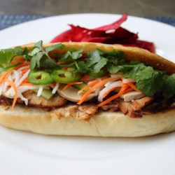 Roasted Pork Banh Mi (Vietnamese Sandwich) Recipe - The crisp, warm meat-filled French roll with cool, crunchy vegetables make this traditional Vietnamese sandwich a delicious variety of flavors and textures.