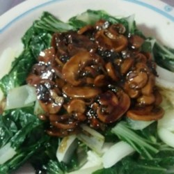 Chinese-Style Baby Bok Choy with Mushroom Sauce Recipe - Baby bok choy, lightly cooked just until bright green, is the star of this Chinese side dish, which gets earthy sweetness from oyster sauce and portobello mushrooms.