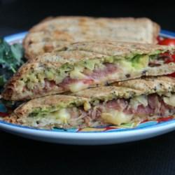 Avocado Prosciutto Ham Sandwich Recipe - A quick and tasty sandwich features avocado, garbanzo beans, prosciutto, and Havarti cheese on toasted pumpernickel.
