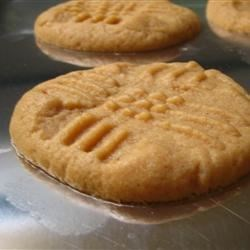 Joey's Peanut Butter Cookies Recipe - My boyfriend's special recipe makes the peanut butteriest tasting cookie I have ever tasted.  These soft and chewy peanut buttery cookies are the best!
