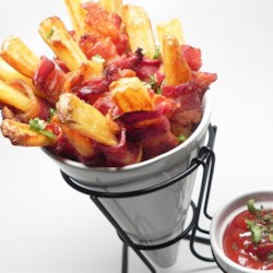 Bacon Fries Recipe - Take steak fries to another level by wrapping each with a slice of bacon for a rich and satisfying snack on game day that is easy to make.