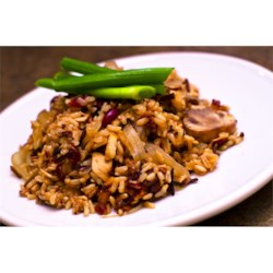 Harvest Rice Dish Recipe - Wild rice, brown rice, slivered almonds, fresh mushrooms, and dried cranberries are simmered in seasoned chicken broth in this delicious rice pilaf.