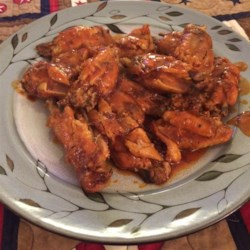 Awesome Slow Cooker Buffalo Wings Recipe and Video - Let the slow cooker do the main work of making spicy, buttery hot wings to serve during the game. The wings are finished in the oven and brushed with more sauce for serving. Great with ranch or blue cheese dressing.