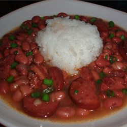 Cajun Style Red Bean and Rice Soup Recipe - This highly seasoned kidney bean soup with ham and andouille sausage is served garnished with cooked white rice and chopped green onions.