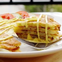 Potato Pancakes Recipe - My family loves these as a side dish or for Sunday brunch.  Delicious topped with sour cream and green onions or applesauce.