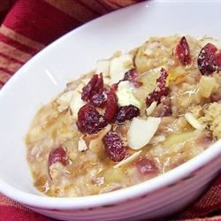 Slow Cooker Fruit, Nuts, and Spice Oatmeal Recipe - This delicious and creamy oatmeal is slow-cooked overnight with apples, cinnamon, cranberries, almonds, and pecans.