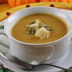 Curry Pumpkin Soup Recipe - Pumpkin puree and vegetable broth form the base of this cream soup flavored with curry and soy sauce.