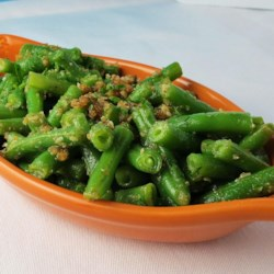Marilyn's Green Beans Italiano Recipe - Fresh green beans are cooked in butter with seasoned bread crumbs and Parmesan cheese for a quick and tasty side dish.