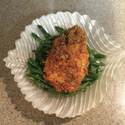 Coconut-Crusted Tilapia - Paleo Recipe - Coconut-crusted tilapia fillets pan-fried in coconut oil are tasty and paleo-friendly. Serve with a side of green veggies!