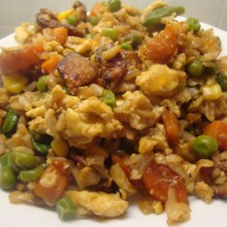 Quick Fried Rice Recipe - Cooked rice fried with egg, bacon, peas, carrots and frozen mixed vegetables.