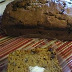 Chocolate Pecan Pumpkin Bread Recipe - Throw this quick bread together in a few minutes, and have a warm slice of pumpkin pecan bread with chocolate chips in no time.
