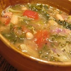 Bean Soup With Kale Recipe - White beans, cannellini or navy, and chicken broth form the base of this soup made with fresh kale and tomatoes.