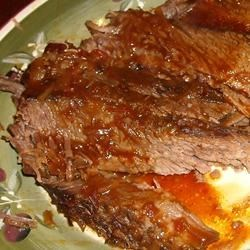 Oven Barbecued Beef Brisket II Recipe - Beef brisket baked in chili sauce, onion soup mix, and cola. Can also be cooked in a slow cooker for 6 to 8 hours.