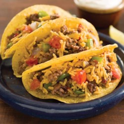Mexican Rice & Beef Tacos Recipe and Video - These beef tacos with bell peppers, onion, and Mexican rice are quick and easy--just what you need after a busy day.