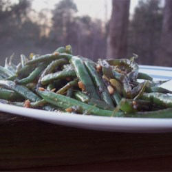 Sweet and Spicy Green Beans Recipe - Fresh green beans are coated with a soy sauce, honey, garlic mixture that is sure to wake up your taste buds!