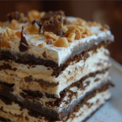 Hot Fudge Ice Cream Bar Dessert Recipe - A layered frozen dessert of ice cream sandwiches, whipped topping, peanuts and peanut butter-chocolate sauce.