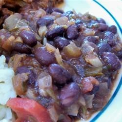 Robin's Sweet and Spicy Black Beans Recipe - Black beans simmer with tomatoes, green chiles, onions, garlic, and spicy seasonings.