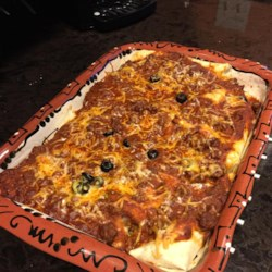 Best Beef Enchiladas Recipe - These easy enchiladas are stuffed with a savory filling of ground beef, Cheddar cheese, black beans, and black olives.