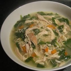 Lemon Chicken Soup II Recipe - Leftover cooked chicken is simmered in chicken broth with rice, spinach and lemon juice in this easy soup.