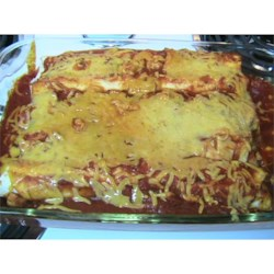 Italian Enchiladas Recipe - Beef and cheese filled tortillas are baked in a creamy, Italian-style sauce.