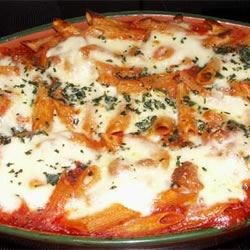 Baked Penne with Italian Sausage Recipe and Video - A simple baked pasta recipe with sausage, tomato sauce, and mozzarella cheese.