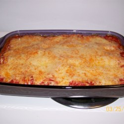 Cheese Lovers' Lasagna Recipe - A cheese extravaganza with mild Cheddar, mozzarella, American, Parmesan, and cottage cheese baked into a lasagna.