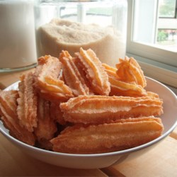 Churros II Recipe - These fried crullers are rolled in cinnamon sugar while still hot. A wonderful treat!