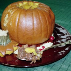 Baked Stuffed Pumpkin Recipe - A beautiful whole baked pumpkin provides an impressive presentation in this versatile dish.  Use as an accompaniment to a turkey dinner, or spoon over home baked pumpkin bread with a dollop of whipped cream to end a meal.