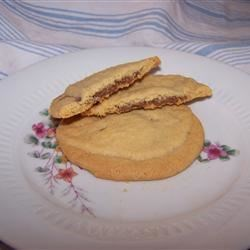 Peanut Butter Chocolate Sandwich Cookies Recipe - Melted chocolate is sandwiched between peanut butter cookies.