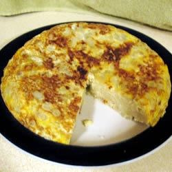 Tortilla de Patata (Spanish Tortilla) Recipe - This is a fine Spanish potluck dish that can be served hot or cold, is inexpensive, delicious, and easy to pack. Hope there will be leftovers to take home, but don't count on it.