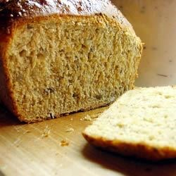 Cracked Wheat Sourdough Bread Recipe - This is a lightly-sweetened wheat sourdough loaf brimming with cracked wheat, flax and sunflower seeds for robust flavor and texture.